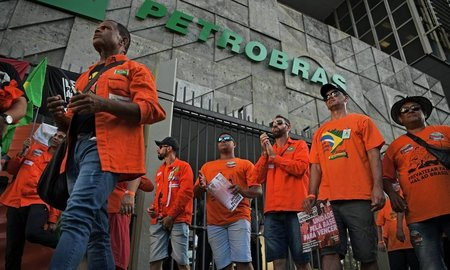 Left or right x87075161 demonstrators protest against layoffs during a strike outside brazils state owned oil comp.jpg.pagespeed.ic.j0e8djmvbb
