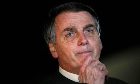 Left or right x88222003 brazils president jair bolsonaro speaks with journalists as he arrives at alvorada pal.jpg.pagespeed.ic.4jssca78ij